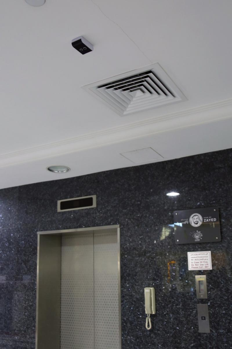 Navigation sensor installed on the ceiling next to an elevator door